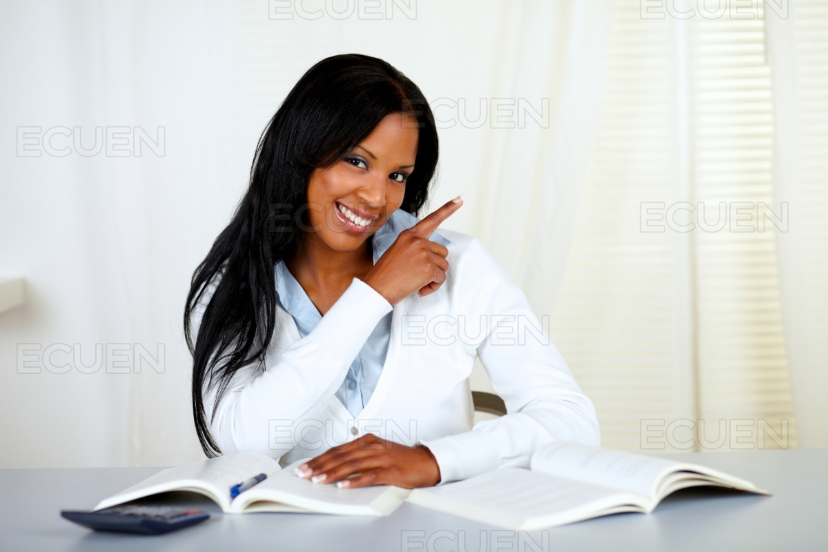 Afro-american student smiling and pointing stock photo
