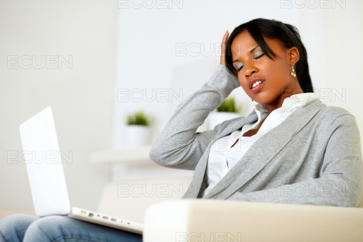 Afro-american tired young woman with headache stock photo