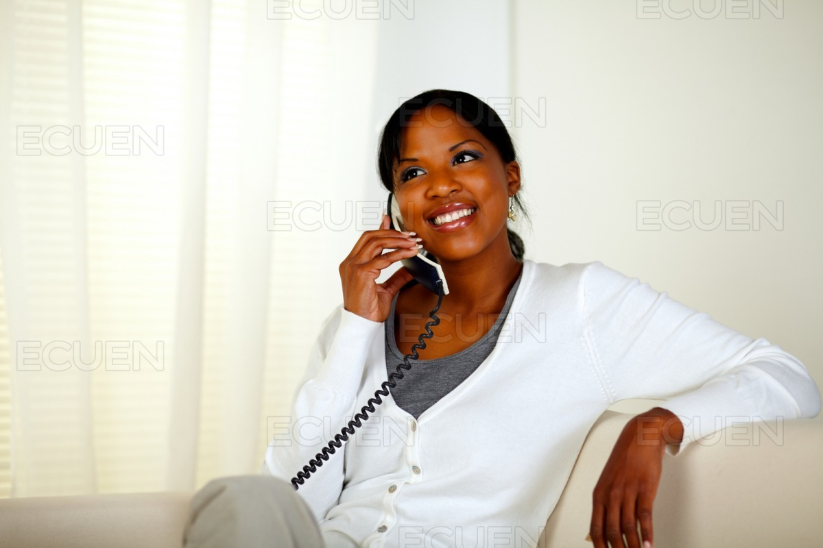 Afro-american woman speaking on phone stock photo