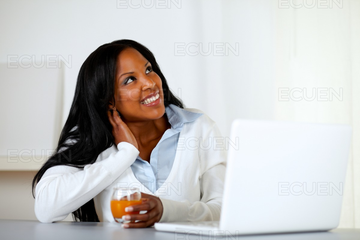 Afro-american young woman looking up stock photo