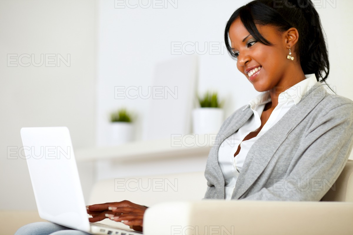 Afro-american young woman using laptop stock photo