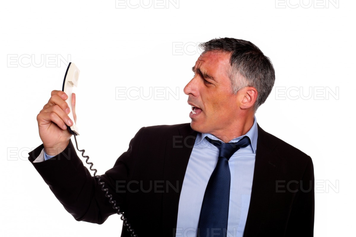 Angry executive screaming on phone stock photo