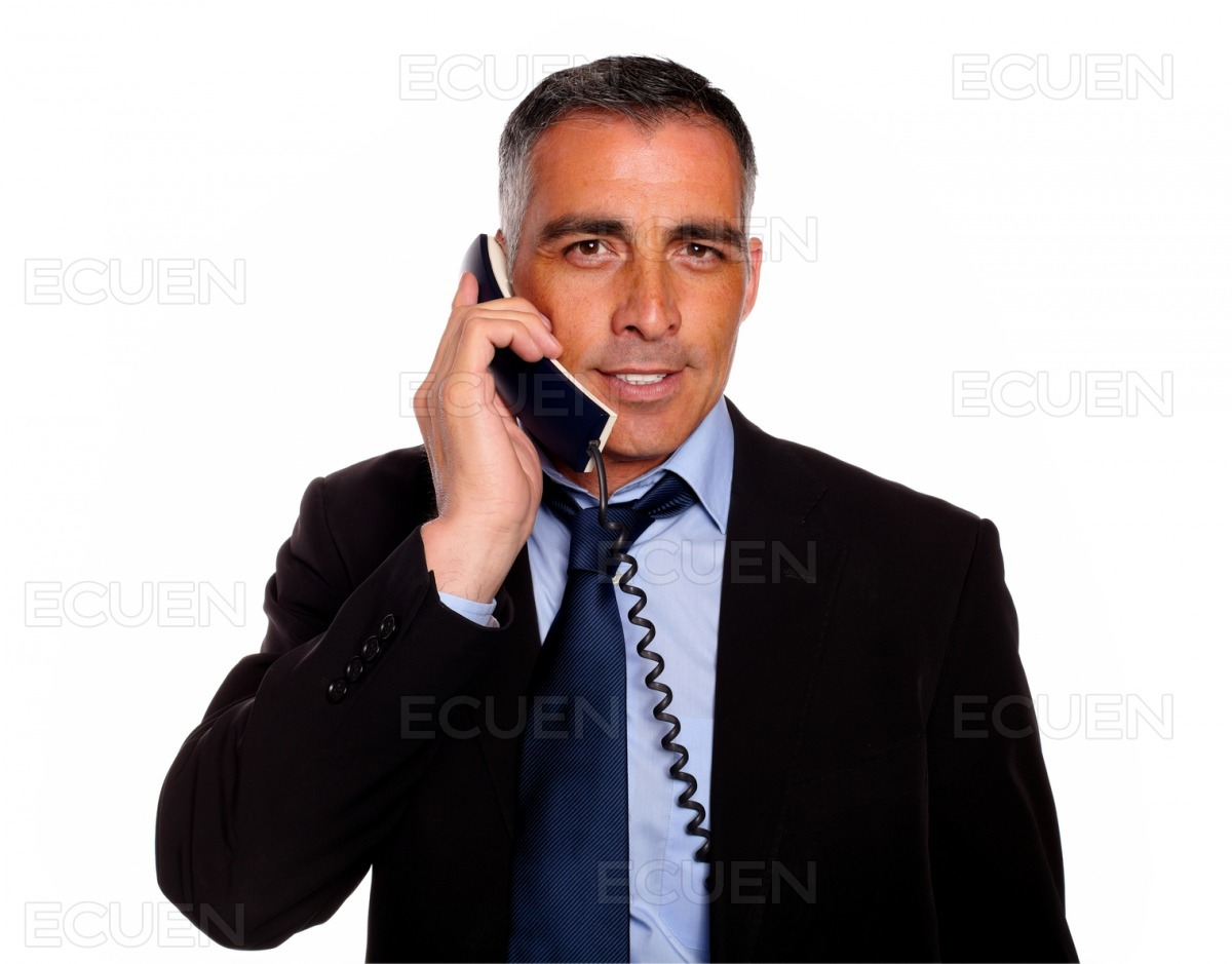 Attractive and gorgeous businessman with a phone stock photo
