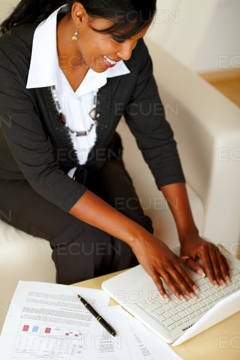 Attractive businesswoman working on laptop stock photo