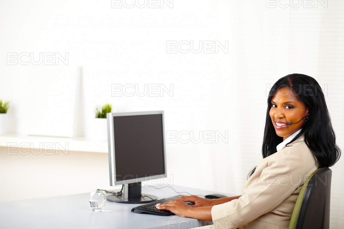 Attractive call center operator at work stock photo