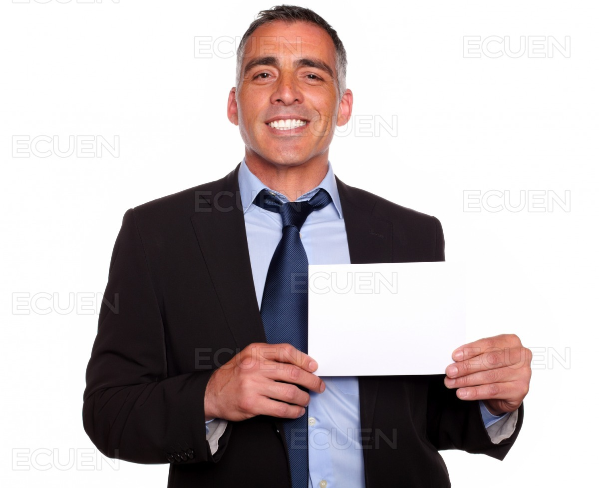 Attractive man smiling and showing a while card stock photo