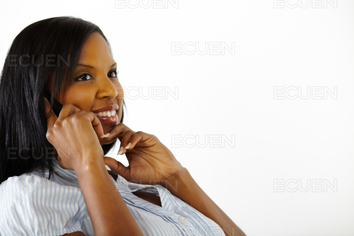 Beautiful young woman speaking on cell phone stock photo