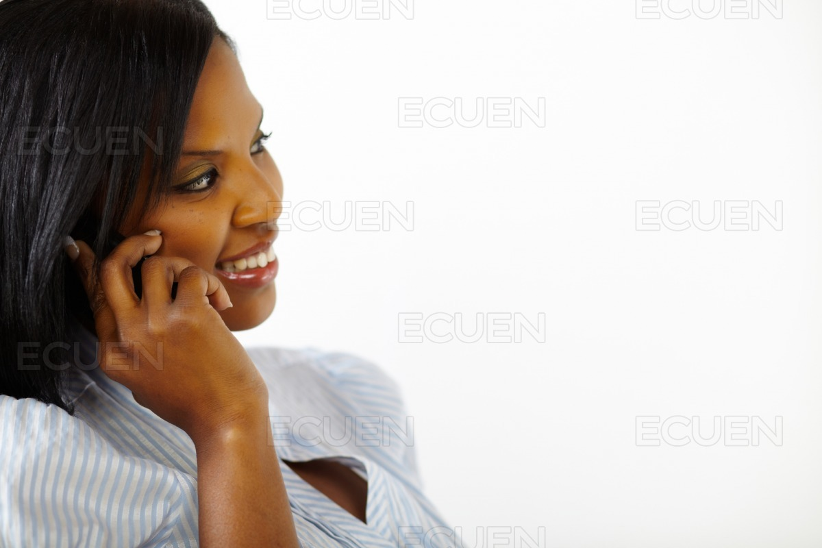 Beautiful young woman talking on mobile phone stock photo