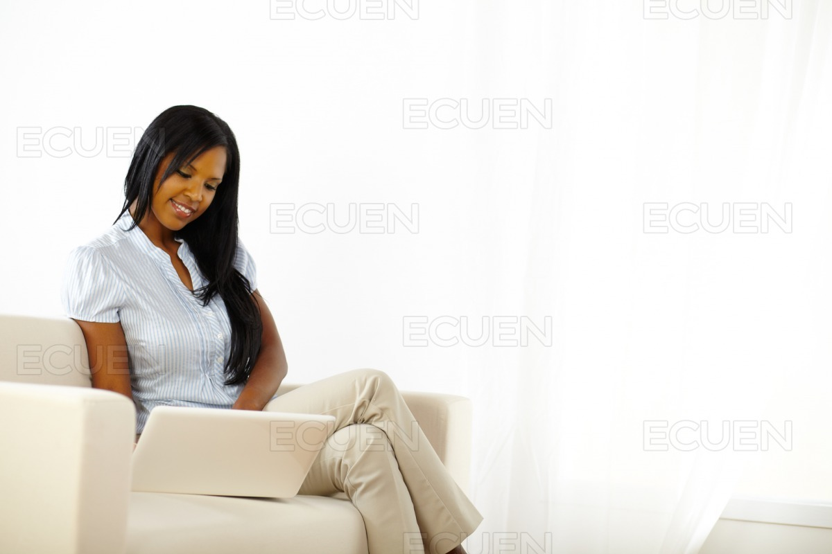 Black young woman browsing on laptop stock photo