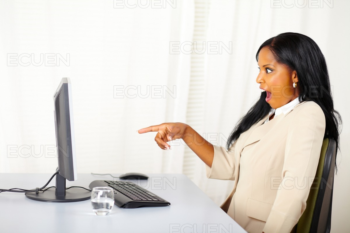 Business lady pointing the computer screen stock photo