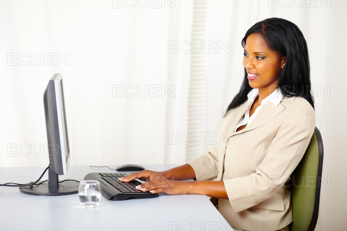 Businesswoman using a computer stock photo
