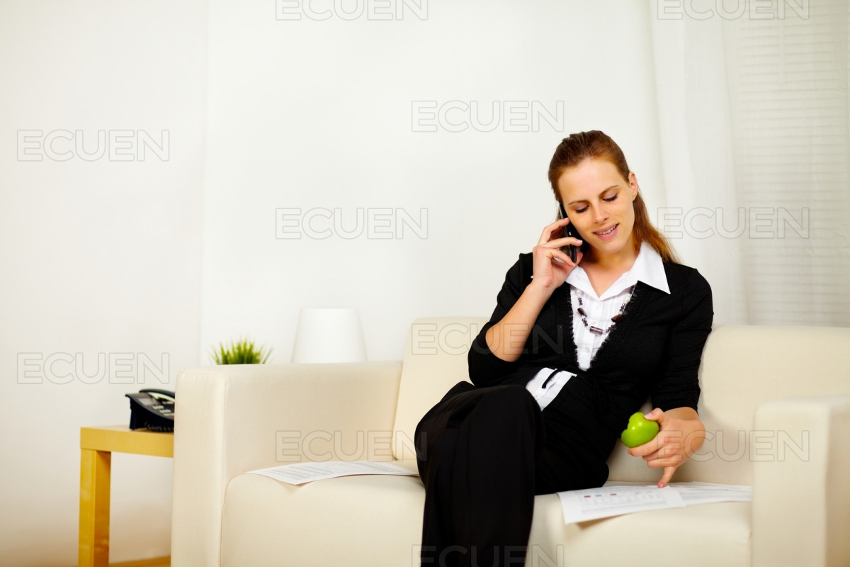 Caucasian young business woman working on sofa stock photo
