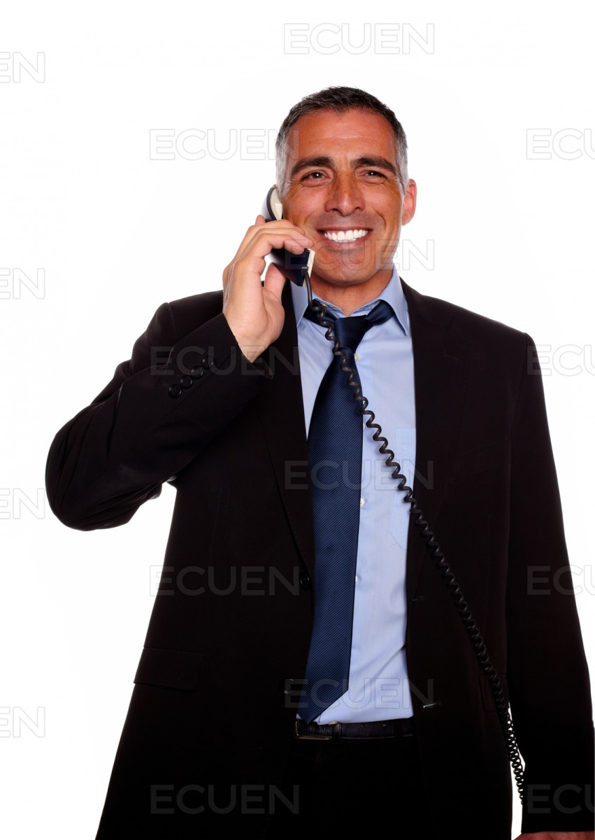 Charismatic businessman laughing on phone stock photo
