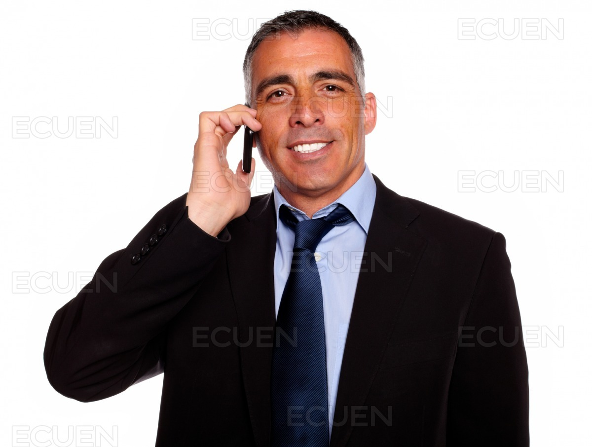 Charismatic businessman speaking on cellphone stock photo