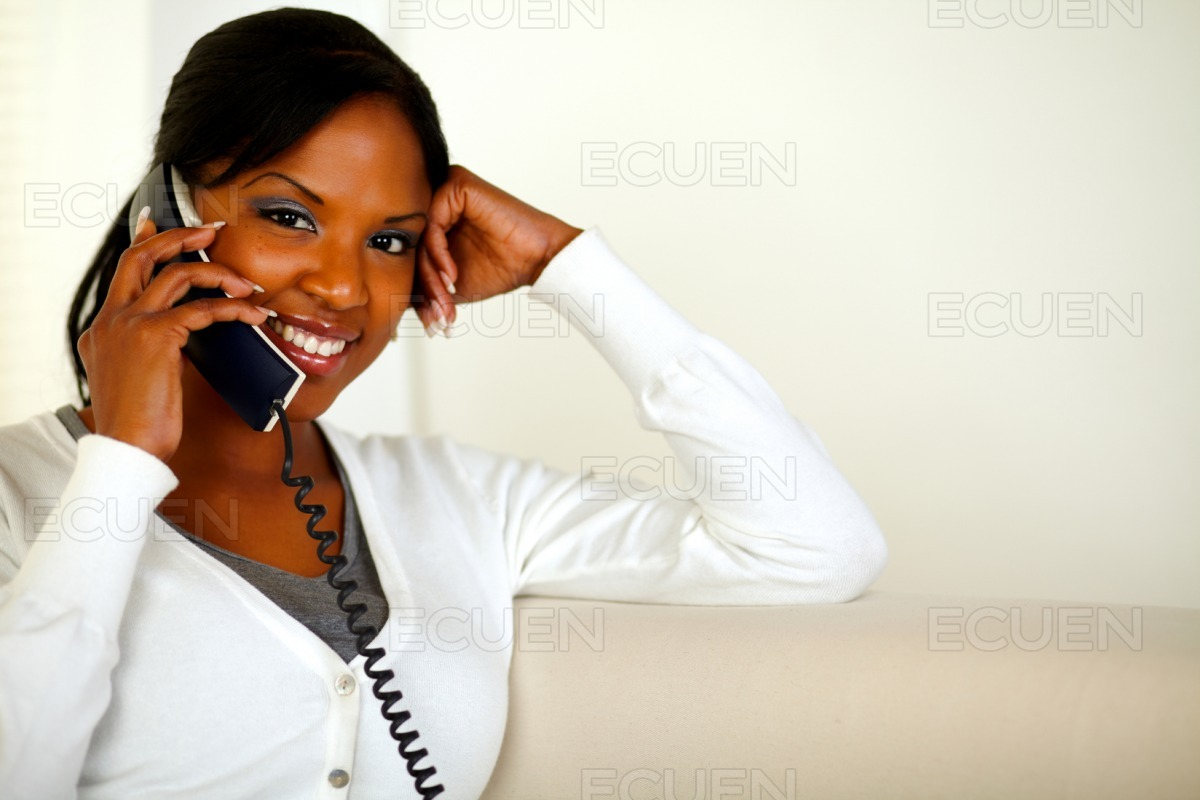 Charming black woman looking and smiling at you stock photo