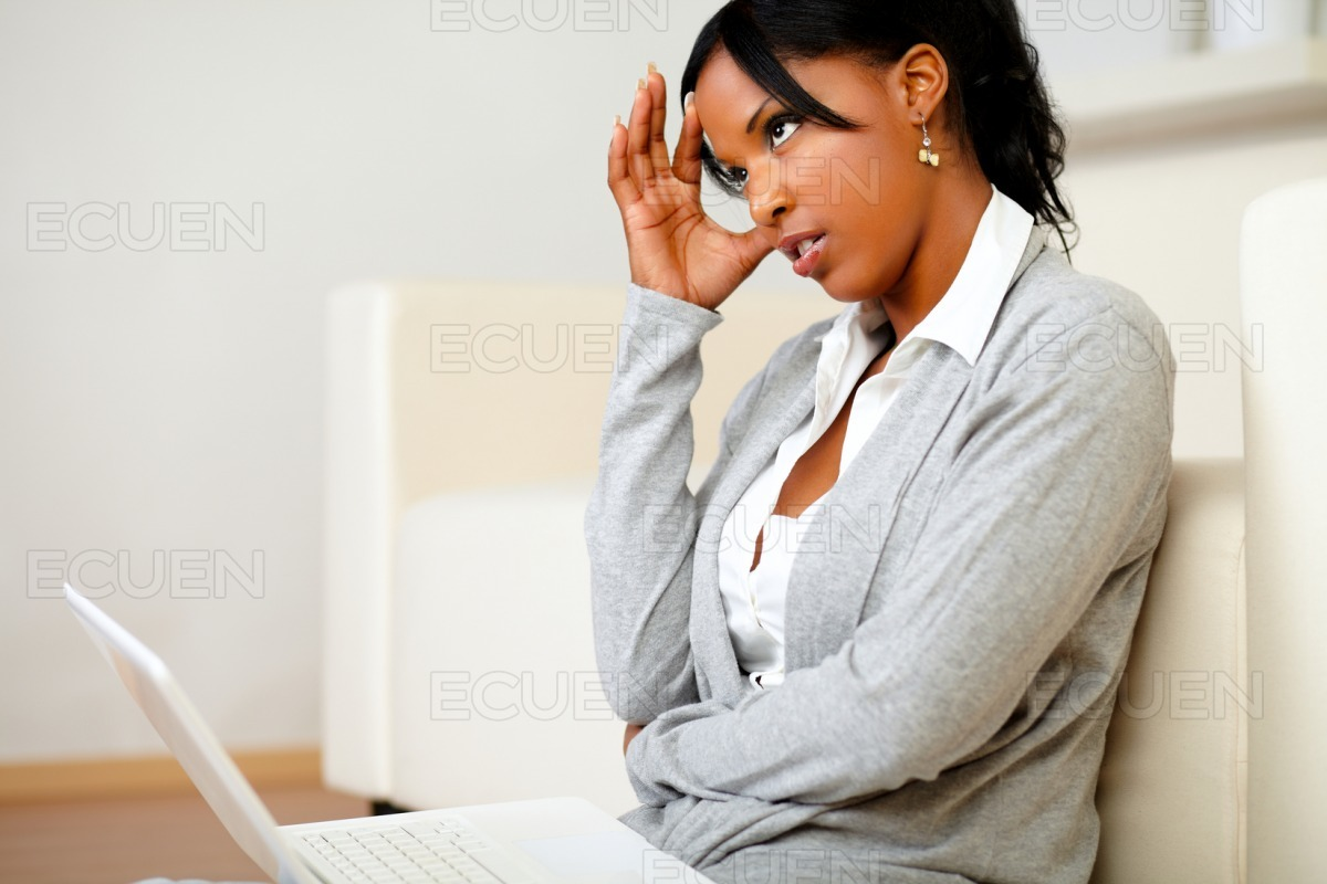 Charming young woman sitting on the floor stock photo