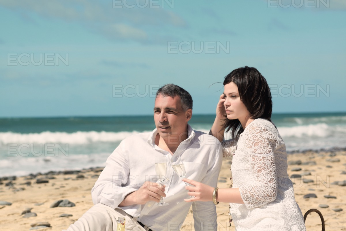 Couple looking to the horizon with glasses stock photo