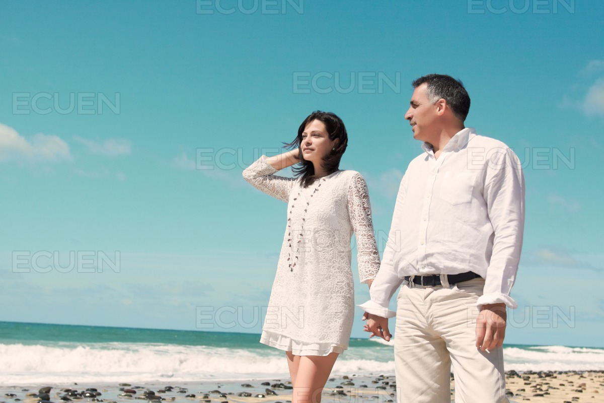 Couple standing at the beach stock photo