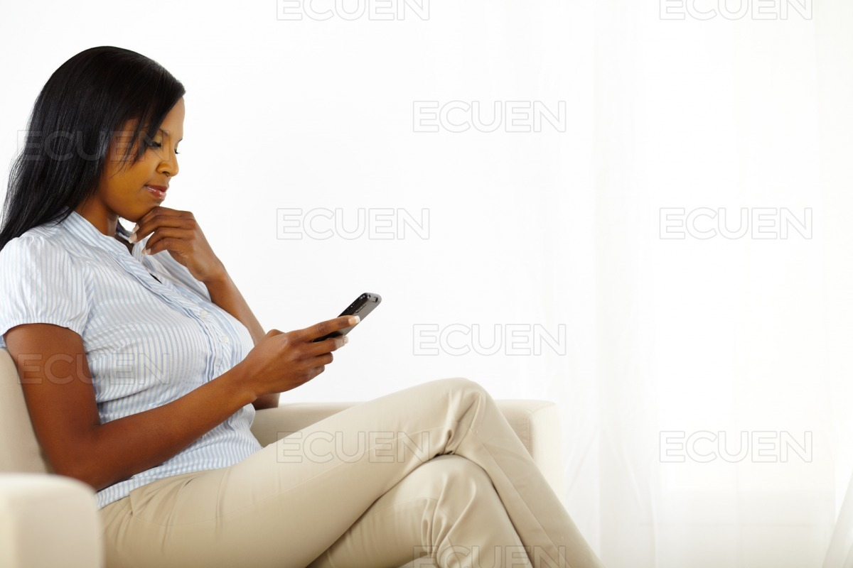 Cute young woman reading a text message stock photo