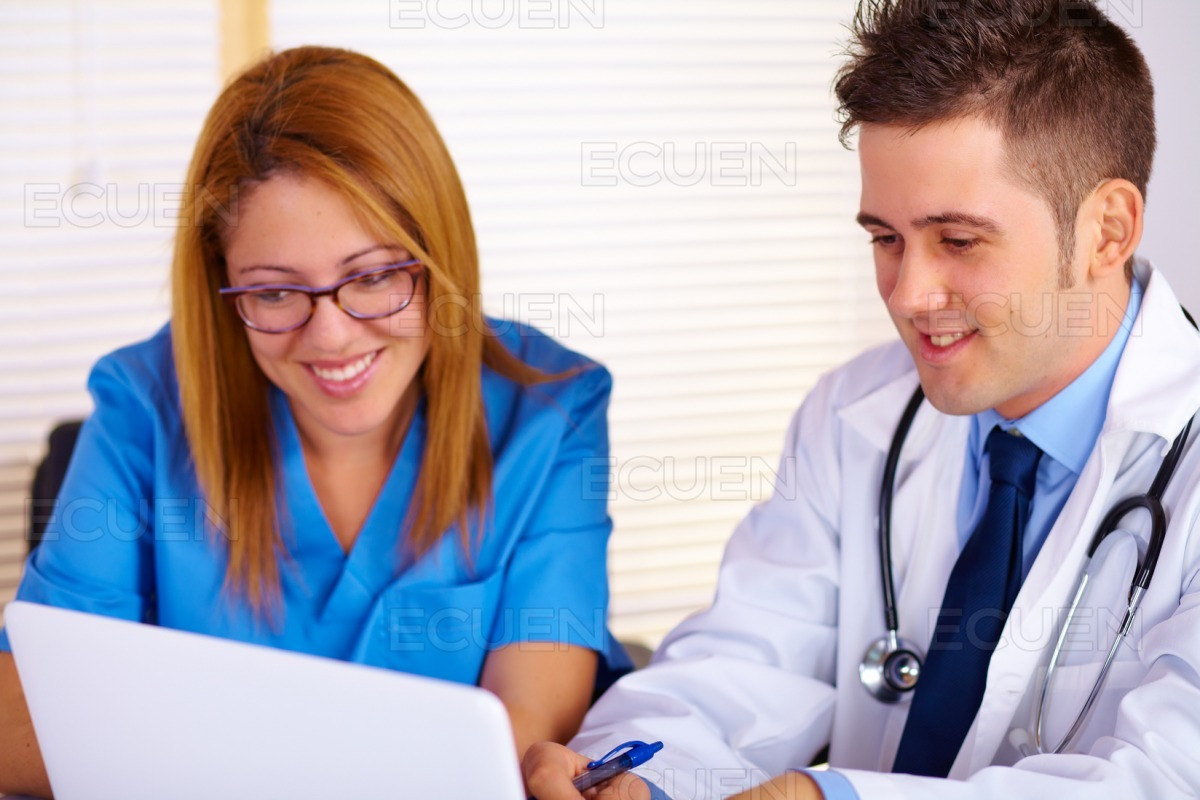 Doctor and a nurse talking stock photo