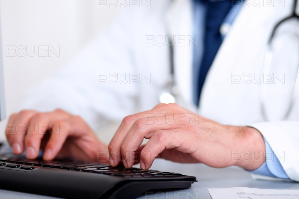 Doctor hands using a computer stock photo