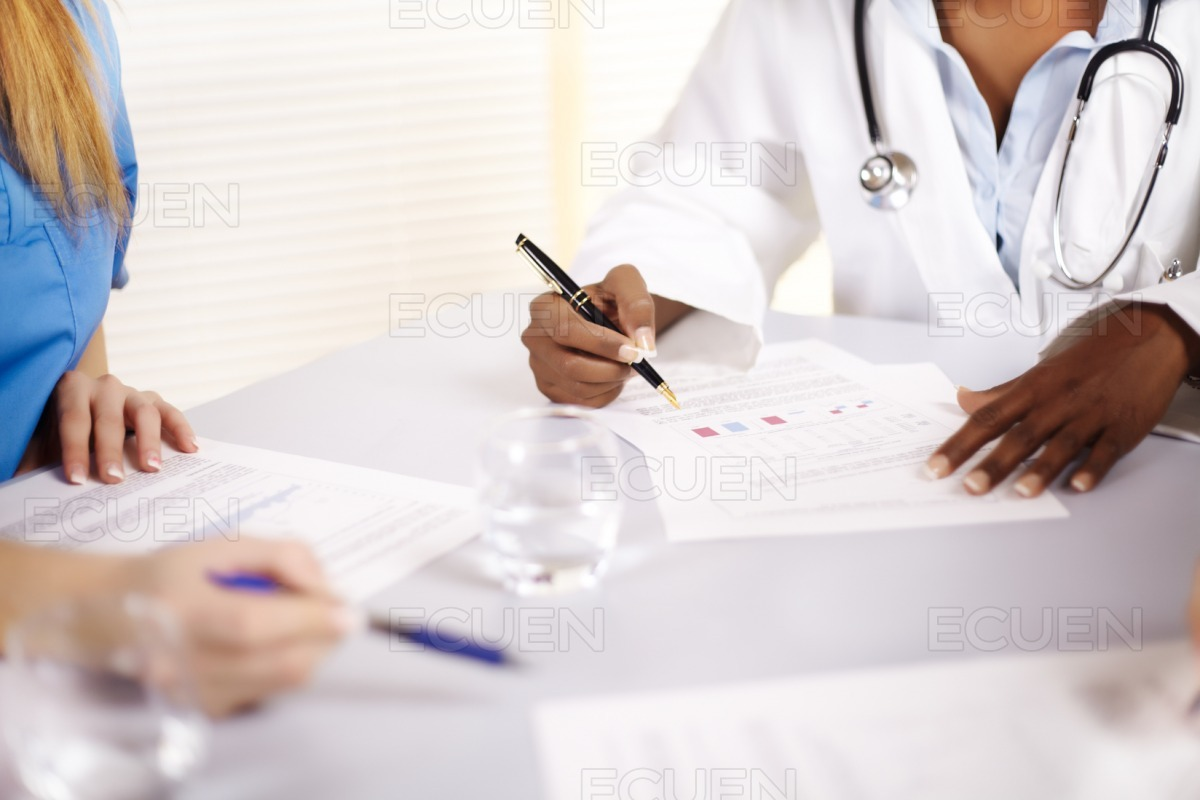 Doctor talking on a meeting stock photo