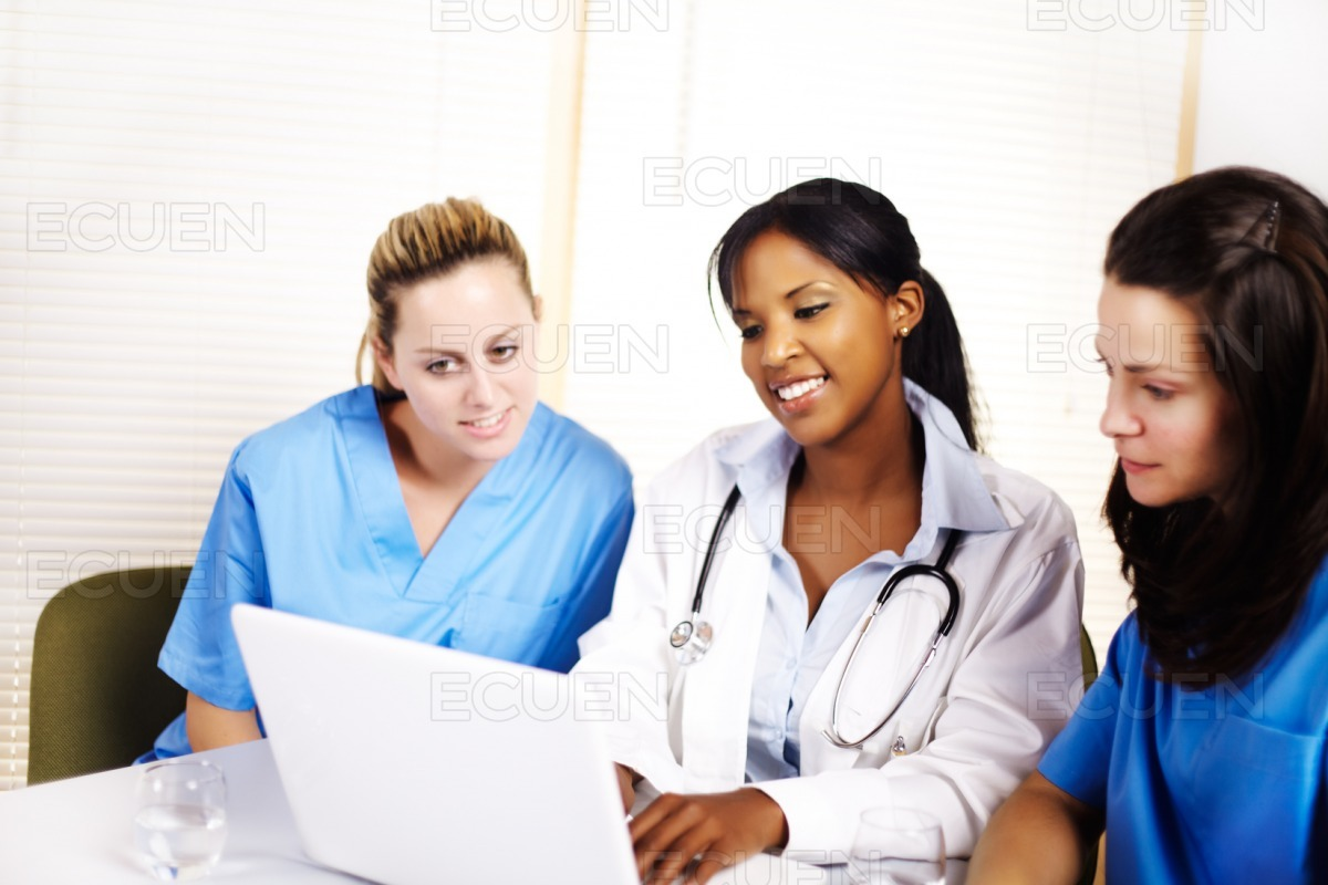 Doctor with a laptop stock photo