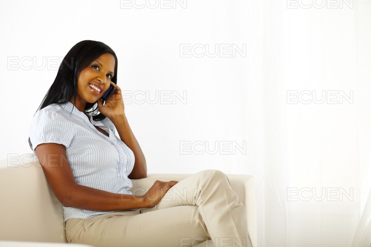 Elegant black young woman on mobile stock photo