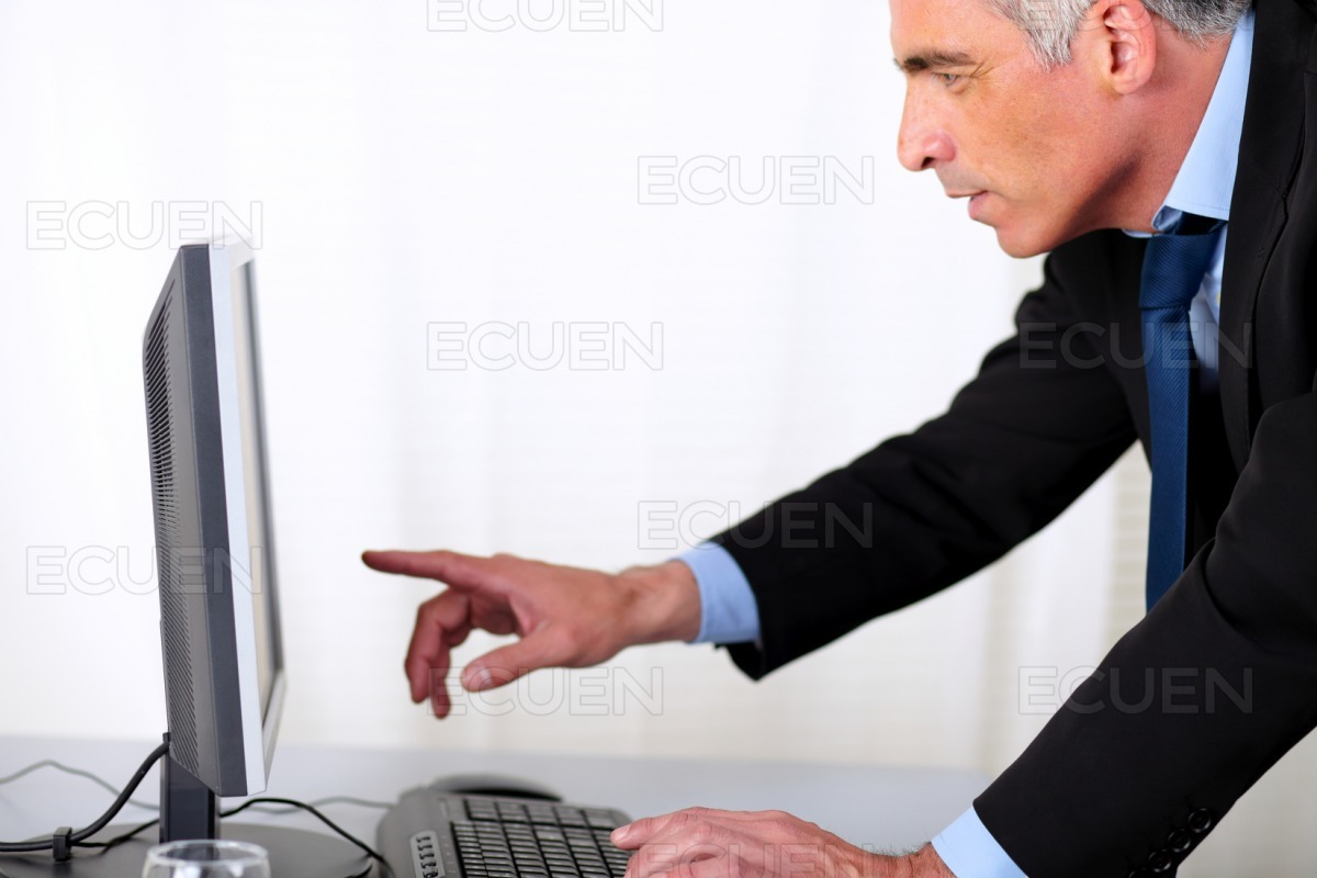 Elegant hipanic business man pointing the computer stock photo