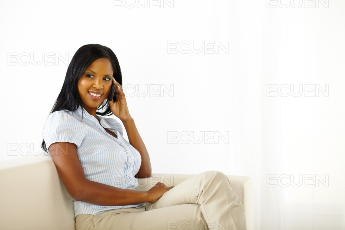 Friendly young woman on cell phone stock photo