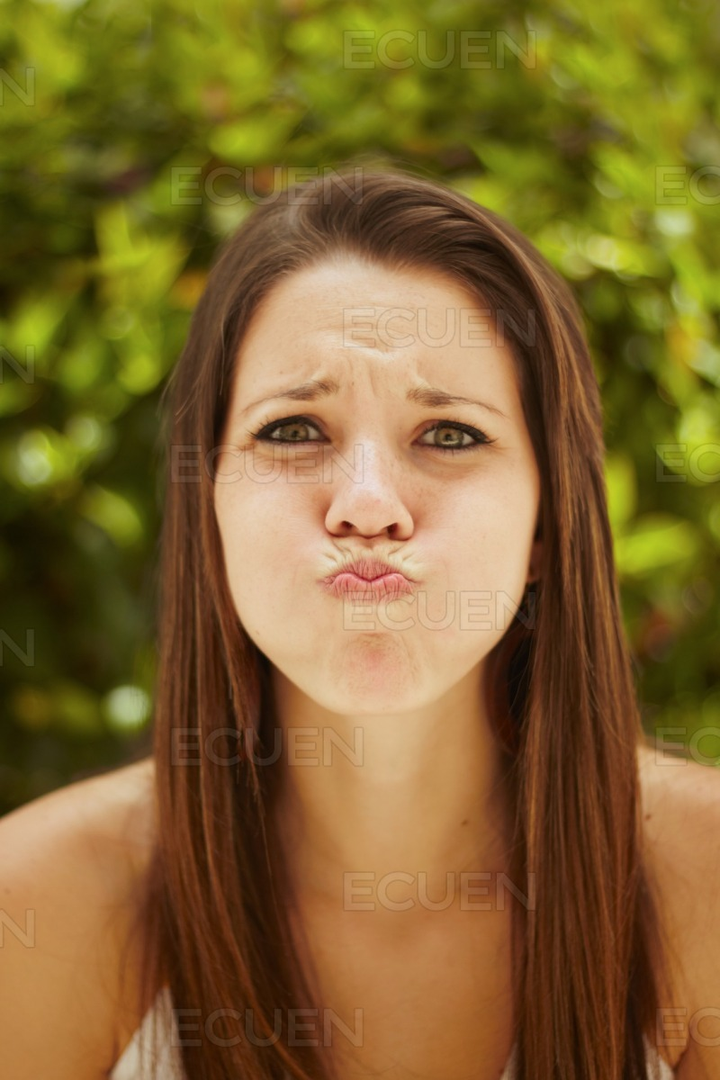 Girl with a mouthful stock photo