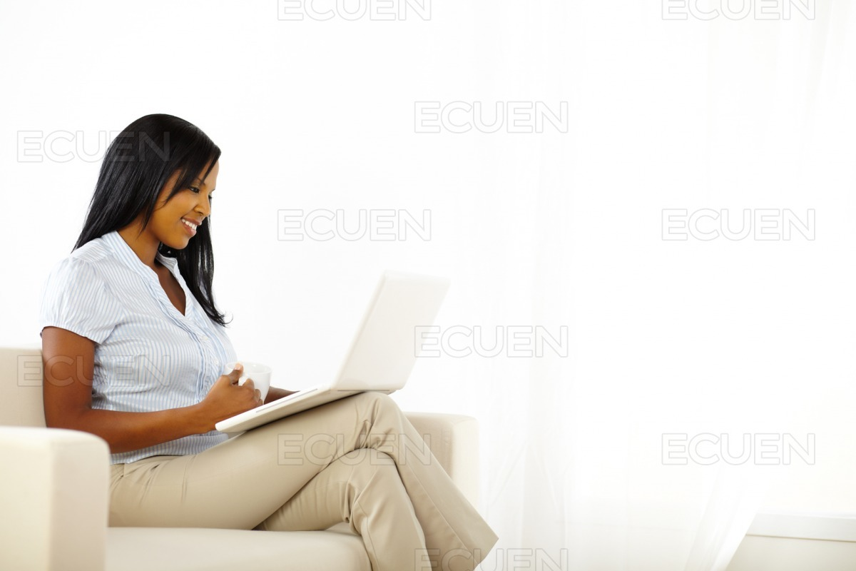Gorgeous young woman working on laptop stock photo