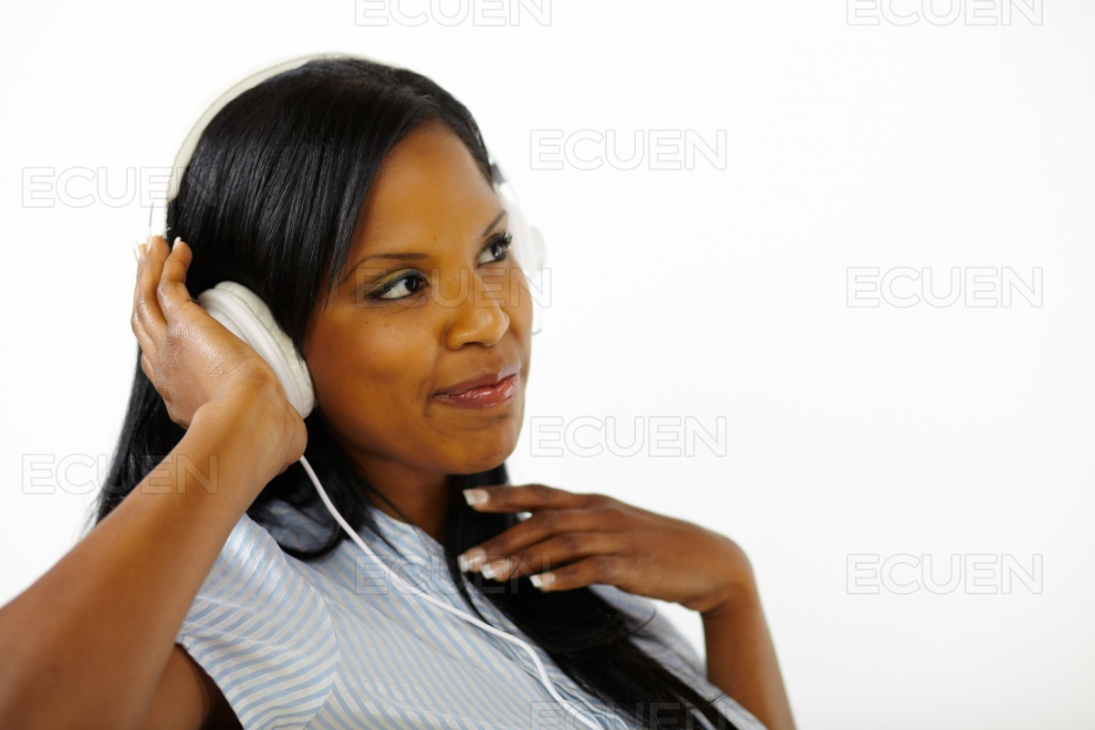 Happy relaxed young lady listening to music stock photo