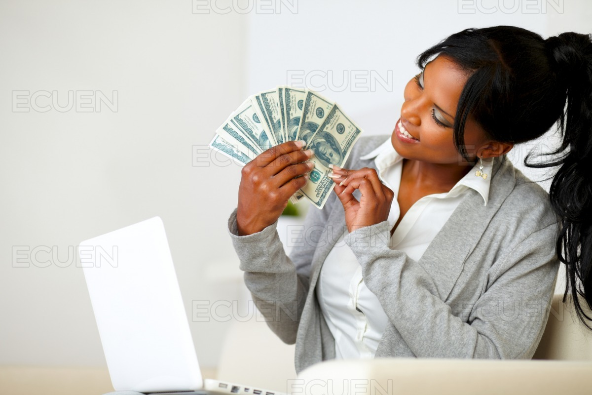 Happy woman looking to dollars stock photo