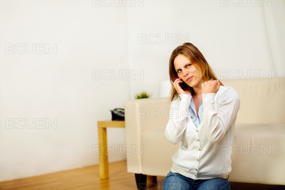 Happy woman on phone celebrating a victory stock photo