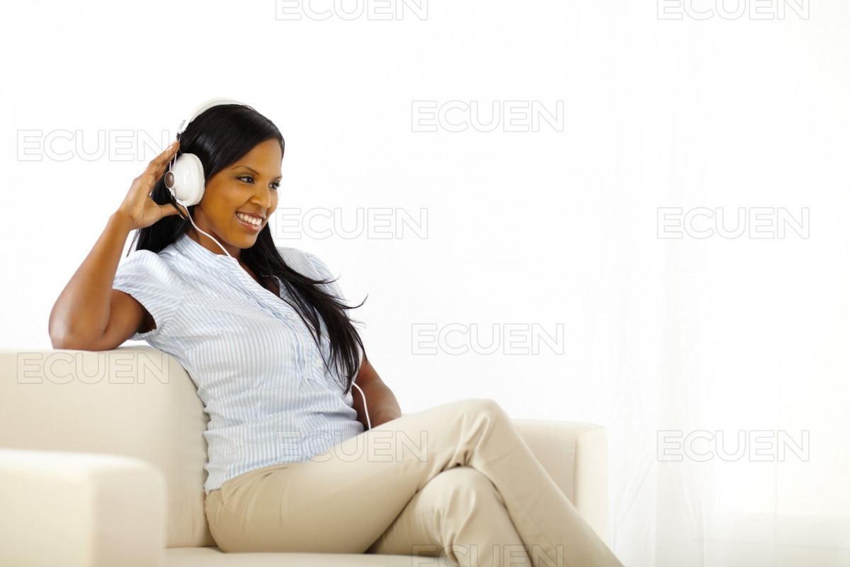 Happy young lady listening to music stock photo