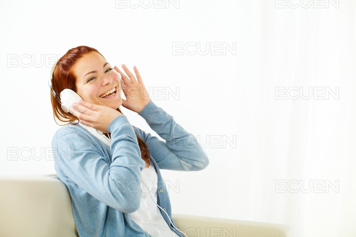 Happy young woman listening to music stock photo