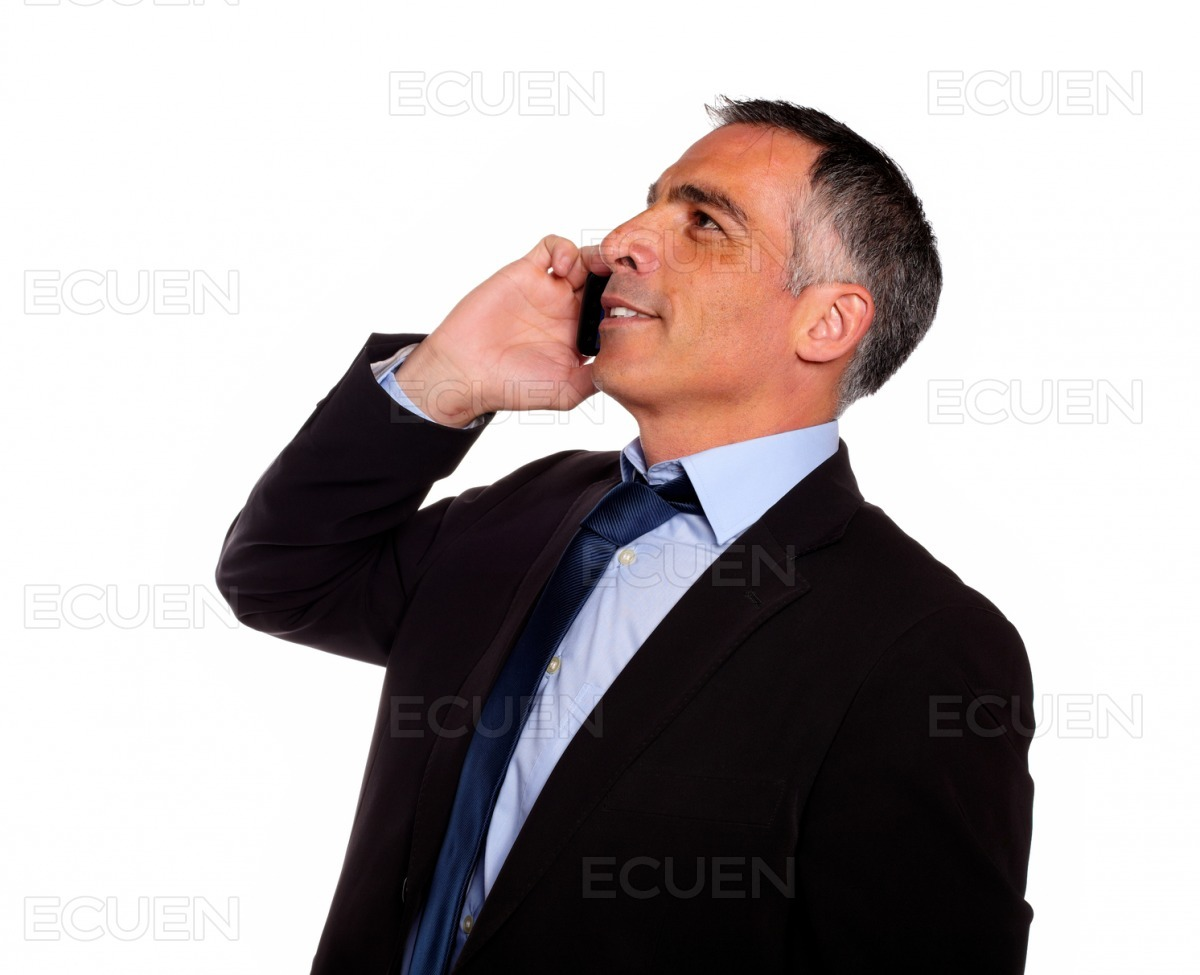 Hispanic professional man conversing with a mobile stock photo
