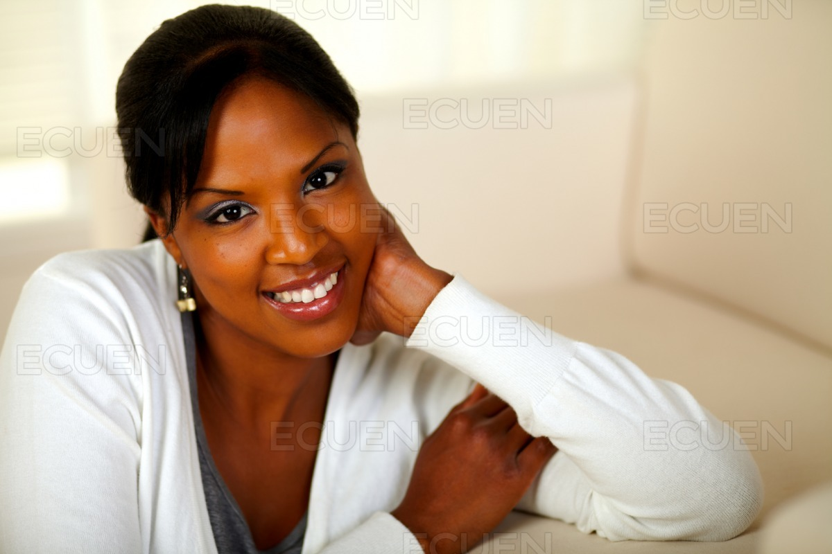 Lovely relaxed girl smiling and looking at you stock photo