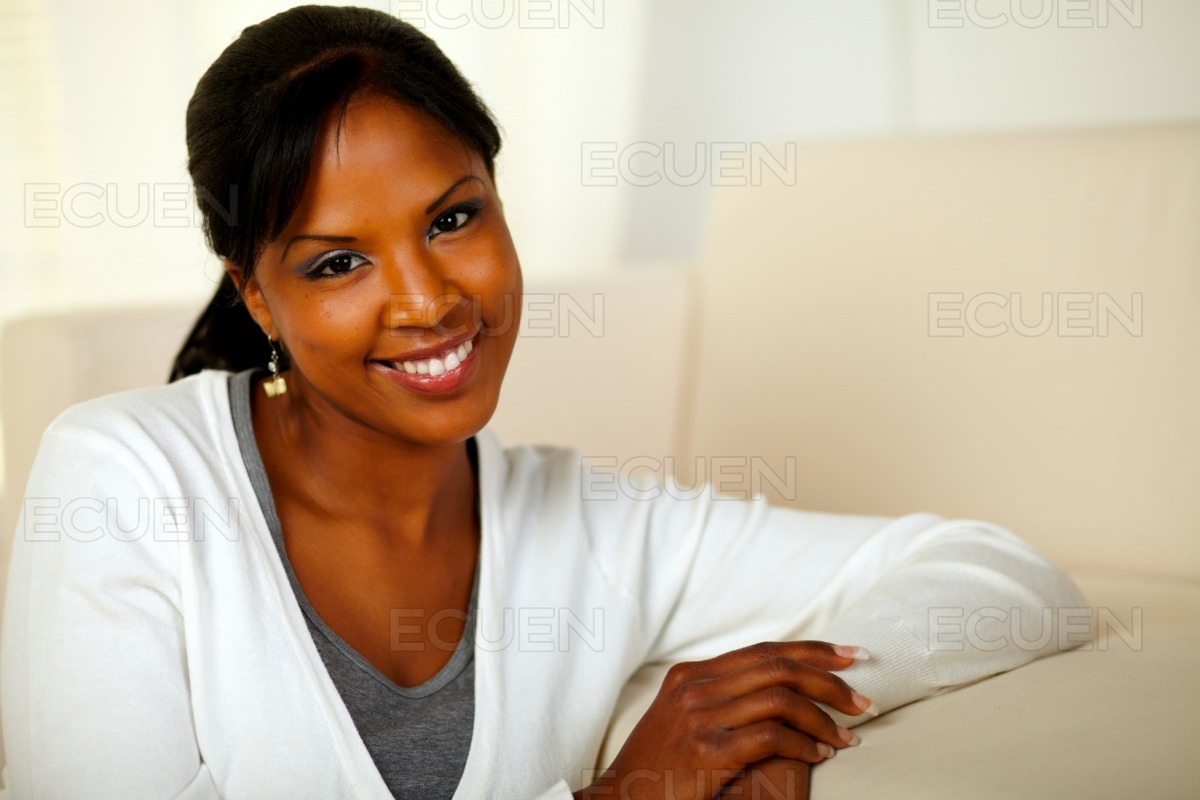 Lovely young female smiling and looking at you stock photo