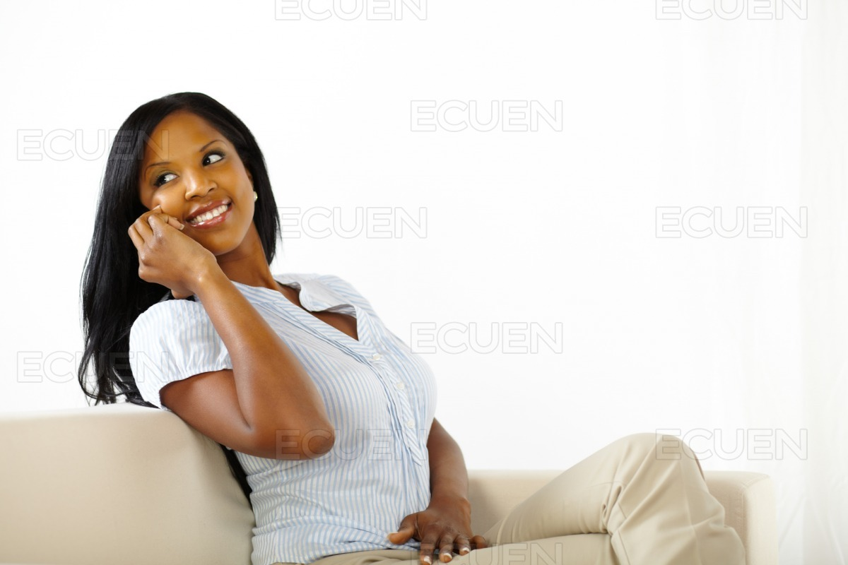 Lovely young woman on mobile stock photo