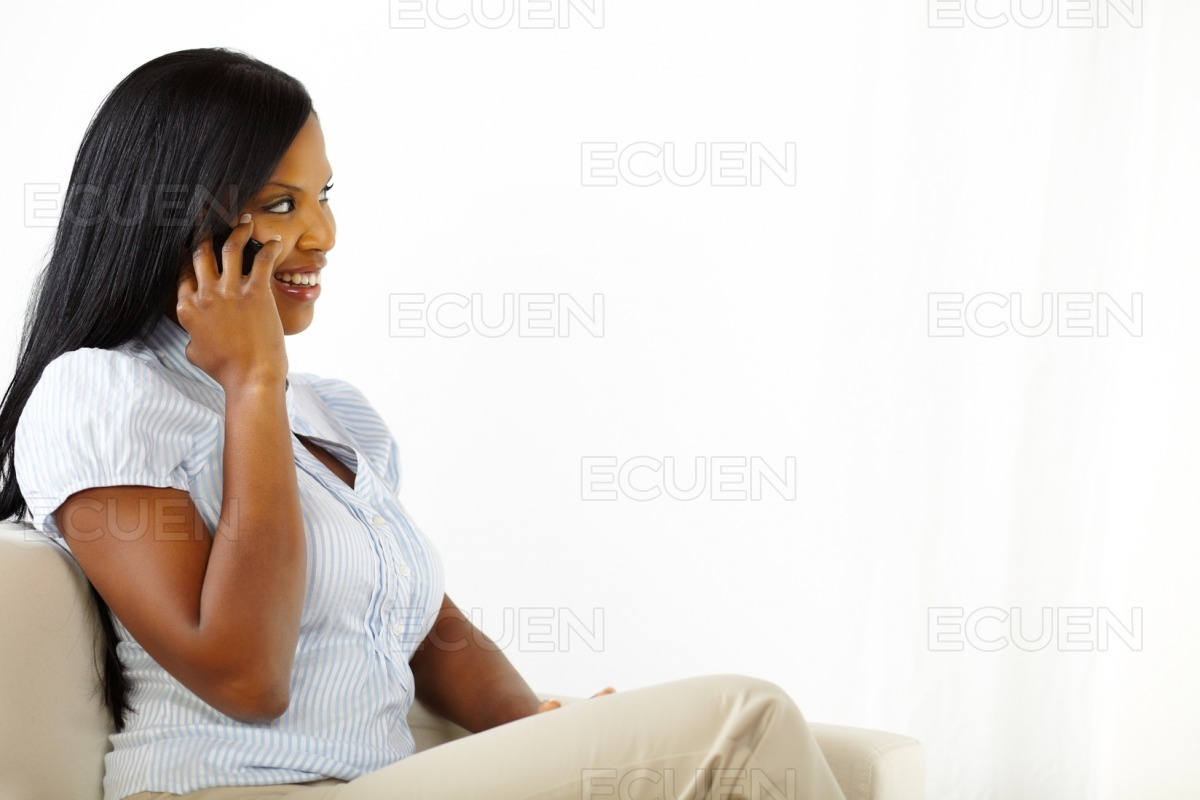 Lovely young woman talking at mobile stock photo