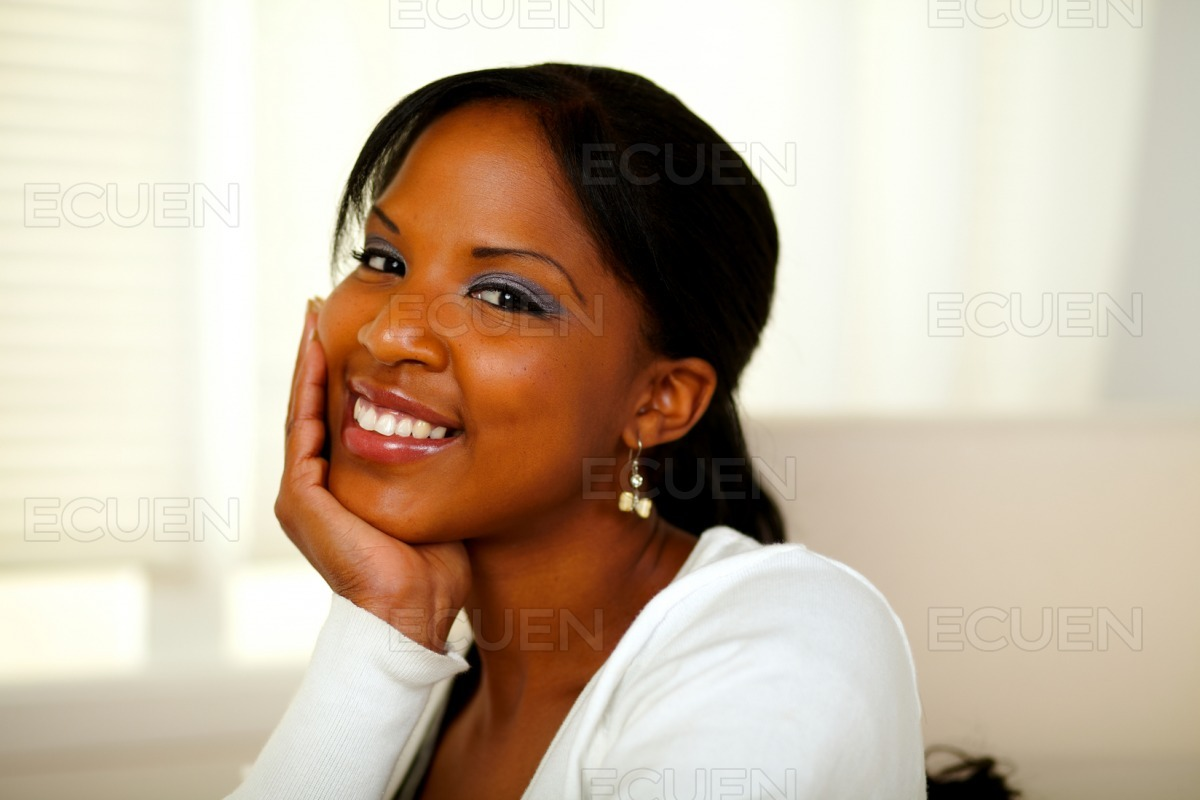 Positive afro-american pretty woman looking at you stock photo