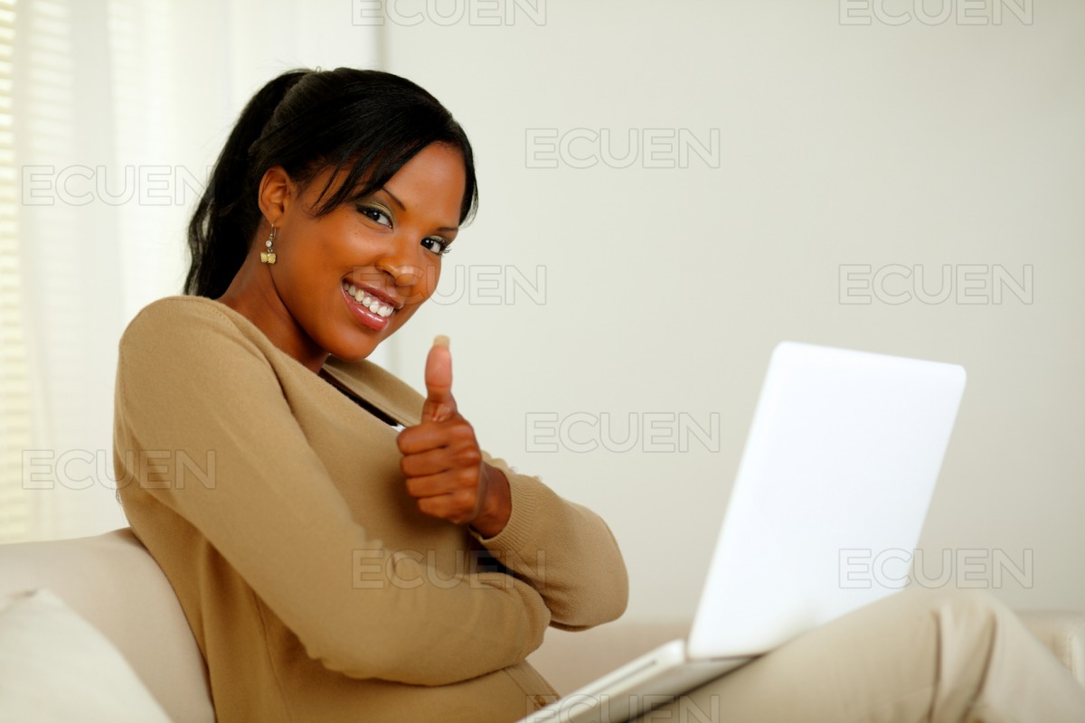 Positive young afro-american woman looking at you stock photo