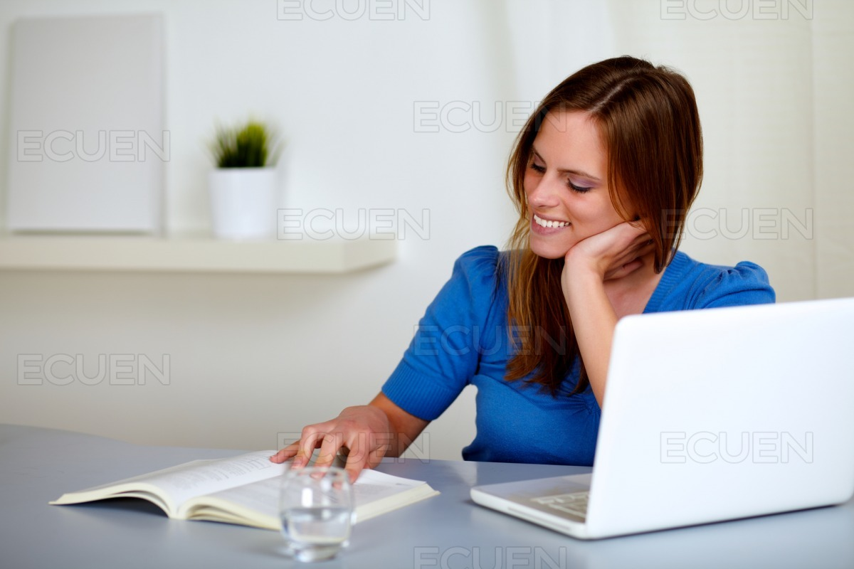 Pretty blonde student girl smiling and learning stock photo