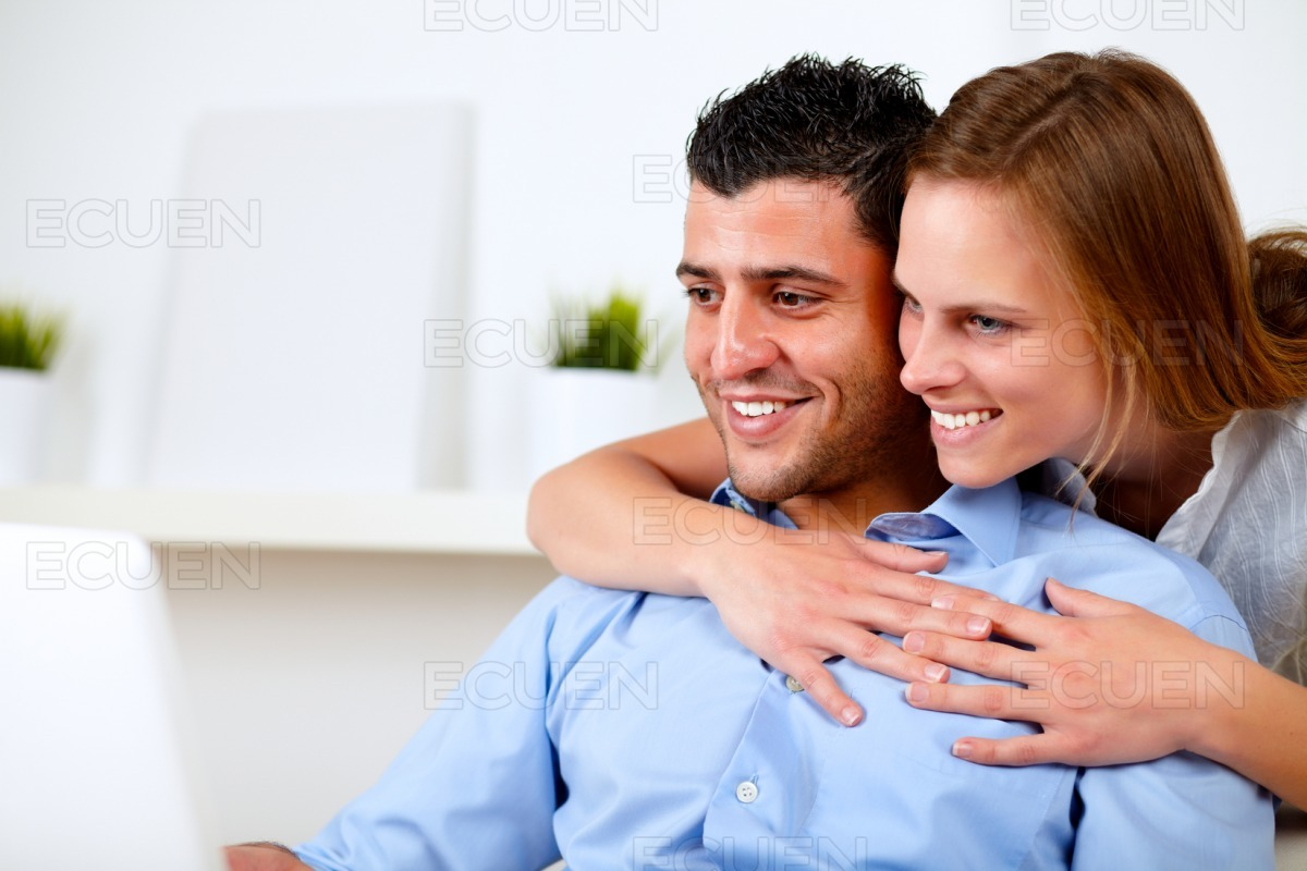 Pretty young couple browsing Internet stock photo