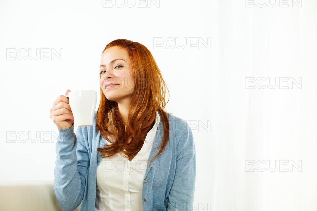 Pretty young female enjoying a caffee cup stock photo