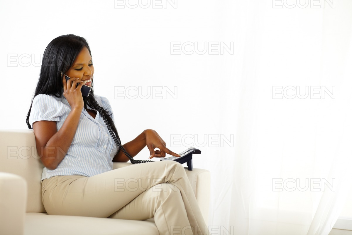 Pretty young lady calling someone stock photo