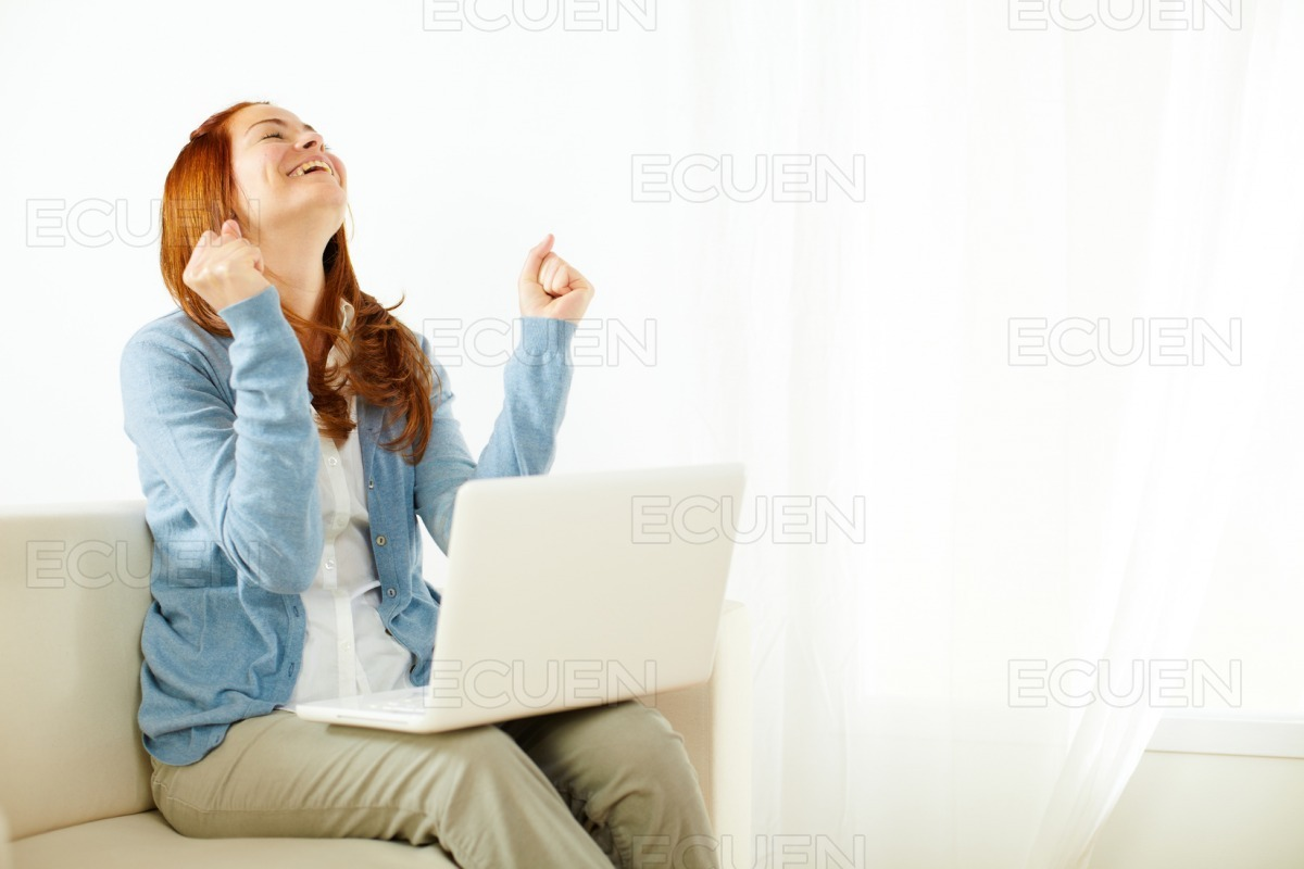 Pretty young woman celebrating a success stock photo