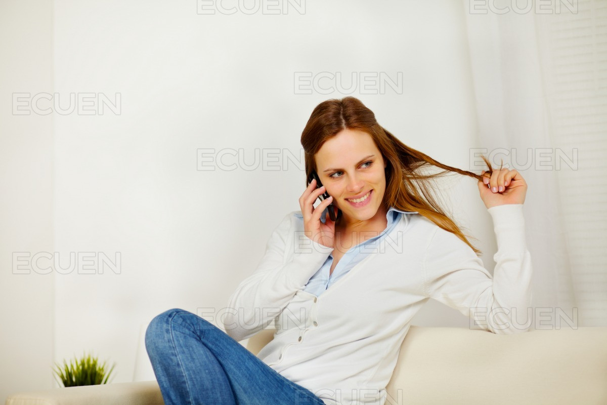 Pretty young woman using a mobile phone stock photo